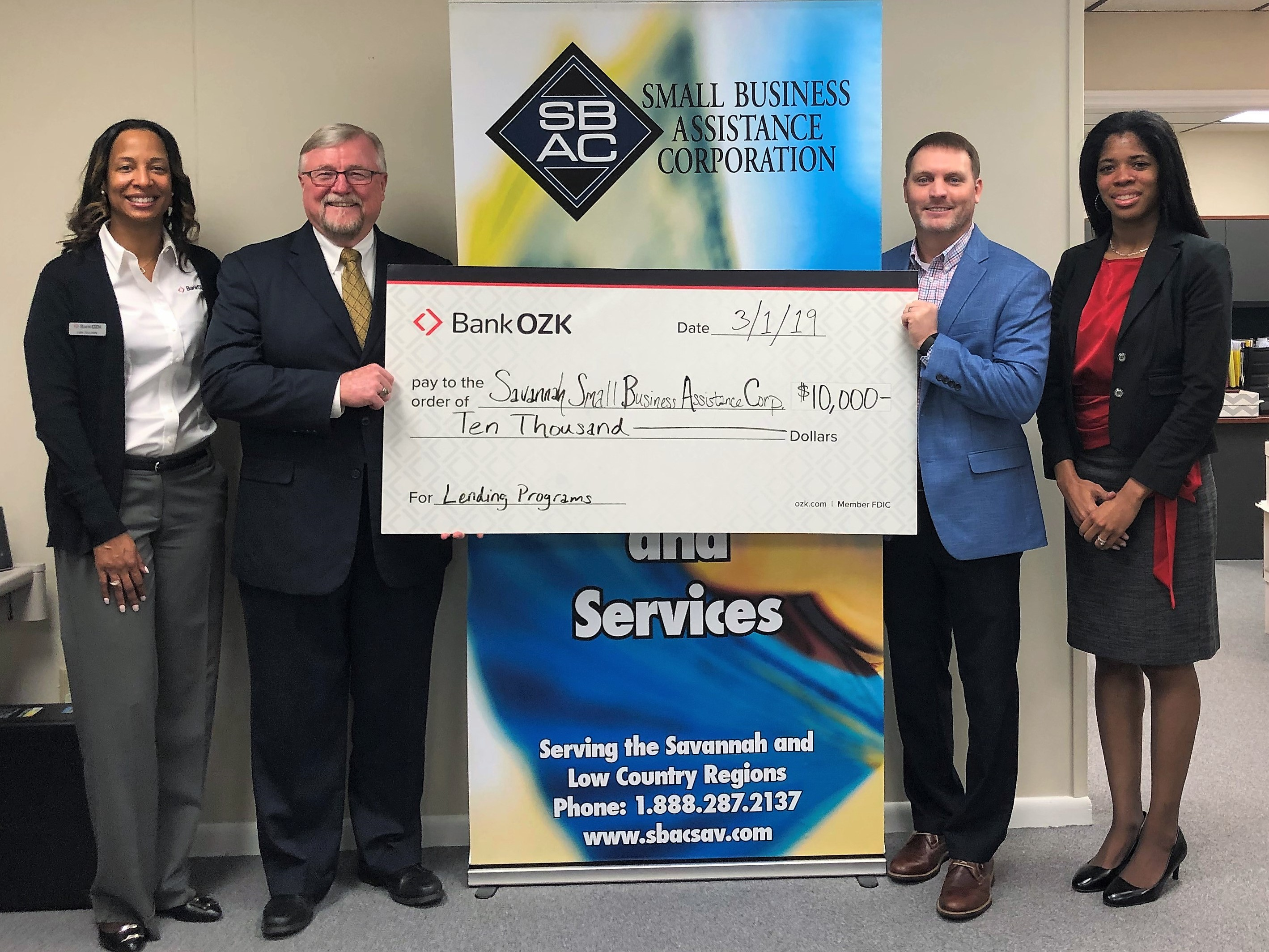 BANK OZK presenting check to Small Business Assistance Corporation